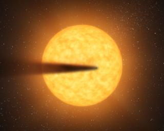 This artist's concept depicts a comet-like tail of a possible disintegrating super Mercury-size planet candidate as it transits, or crosses, its parent star, named KIC 12557548. The results are based on data from NASA's Kepler mission.