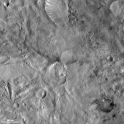 This image from NASA's Dawn spacecraft of asteroid Vesta shows Helena crater, which is the crater that resembles the shape of a butterfly's wings (center), and Laelia crater (bottom right).