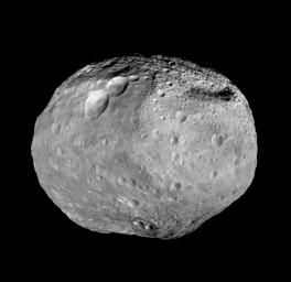 As NASA's Dawn spacecraft takes off for its next destination, this mosaic synthesizes some of the best views the spacecraft had of the giant asteroid Vesta. The set of three craters known as the 'snowman' can be seen at the top left.