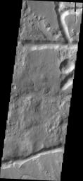 The channel-like features in image captured by NASA's 2001 Mars Odyssey spacecraft are fracture sets related to the formation of Iani Chaos, which occurs directly north of the image.