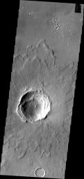This image from NASA's 2001 Mars Odyssey spacecraft contains a relatively young crater and its ejecta. Layering in the ejecta is visible and relates to the shock waves from the impact. This unnamed crater is located in Arabia Terra.