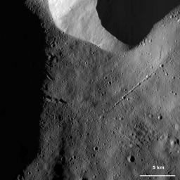 This image from NASA's Dawn spacecraft of asteroid Vesta shows a long chain of craters in the right part of the image, located in Vesta's Caparronia quadrangle, in Vesta's northern hemisphere.