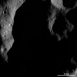 This image from NASA's Dawn spacecraft shows a very shadowed region in Vesta's northern hemisphere. Roughly the upper one third of asteroid Vesta's northern hemisphere is currently in shadow.