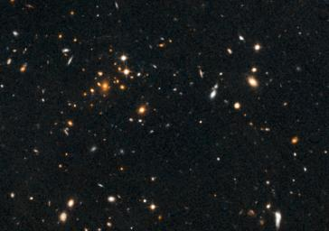 Astronomers using NASA's Hubble Space Telescope have found a puzzling arc of light behind an extremely massive cluster of galaxies residing 10 billion light-years away.