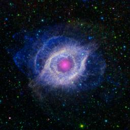 This image from NASA's Spitzer and GALEX shows the Helix nebula, a dying star throwing a cosmic tantrum. In death, the star's dusty outer layers are unraveling into space, glowing from the intense UV radiation being pumped out by the hot stellar core.