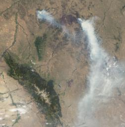 On July 2, 2012, NASA's MISR instrument on NASA's Terra spacecraft passed over the Horse Creek Fire and much larger Ash Creek Fire Complex in southeastern Montana, to the east of Billings, Mont.