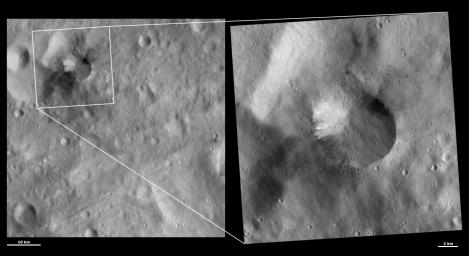 These images from NASA's Dawn spacecraft are located in asteroid Vesta's Gegania quadrangle, in Vesta's southern hemisphere; tiny craters and streaks developed from material can be seen slumping towards the center of the crater.