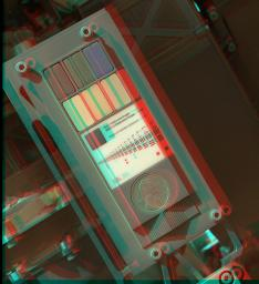 This 3-D view of the calibration target for the MAHLI camera aboard NASA's Mars rover Curiosity was assembled from two images taken by that camera during the 34th Martian day. The camera is on the turret of tools at the end of Curiosity's robotic arm.