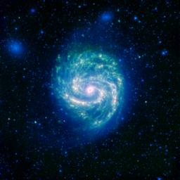 The galaxy Messier 100, or M100, shows its swirling spiral in this infrared image from NASA's Spitzer Space Telescope. The arcing spiral arms of dust and gas that harbor star forming regions glow vividly when seen in the infrared.