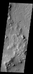 This image from NASA's 2001 Mars Odyssey spacecraft shows the region just northwest of yesterday's image of Gale Crater. This region is dissected by small channels.