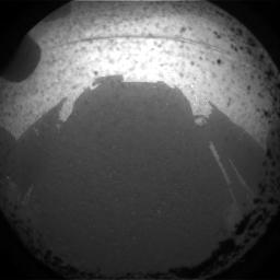 This is the first image taken by NASA's Curiosity rover, which landed on Mars the evening of Aug. 5 PDT (morning of Aug. 6 EDT). It was taken through a 'fisheye' wide-angle lens on one of the rover's front left Hazard-Avoidance cameras.