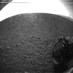 This is one of the first images taken by NASA's Curiosity rover, which landed on Mars the evening of Aug. 5 PDT (morning of Aug. 6 EDT). The clear dust cover that protected the camera during landing has been sprung open.