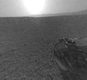 This is a version of one of the first images taken by a rear Hazard-Avoidance camera on NASA's Curiosity rover and shows part of the rim of Gale Crater, which is a feature the size of Connecticut and Rhode Island combined.