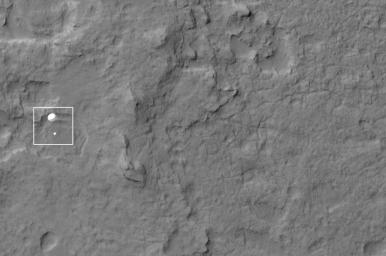 NASA's Curiosity rover and its parachute were spotted by NASA's Mars Reconnaissance Orbiter as Curiosity descended to the surface on Aug. 5 PDT (Aug. 6 EDT). Curiosity and its parachute are in the center of the white box.