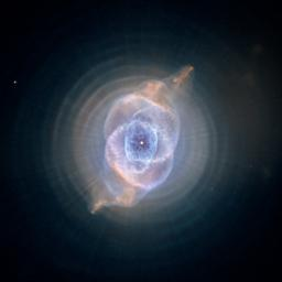 This detailed view of NGC 6543, the Cat's Eye Nebula, from NASA's Hubble Space Telescope includes intricate structures, including concentric gas shells, jets of high-speed gas, and unusual shock-induced knots of gas.