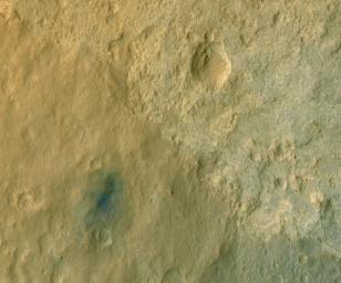 This color-enhanced view of NASA's Curiosity rover on the surface of Mars was taken by NASA's Mars Reconnaissance Orbiter as the satellite flew overhead. The descent stage blast pattern around the rover is clearly seen as relatively blue colors.
