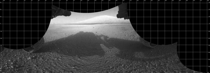The Curiosity engineering team created this cylindrical projection view from images taken by NASA's Curiosity rover front hazard avoidance cameras underneath the rover deck on Sol 0. Pictured here are are the 'pigeon-toed' the wheels.