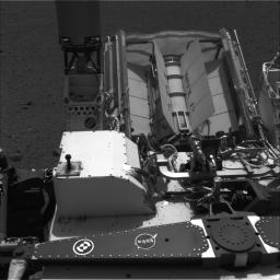 This image shows the calibration target for the Chemistry and Camera (ChemCam) instrument on NASA's Curiosity rover. The calibration target is one square and a group of nine circles that look dark in the black-and-white image.