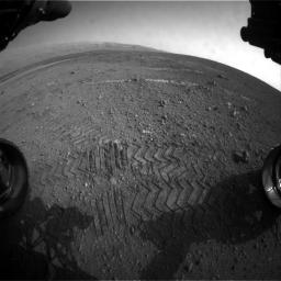 This image taken by a front Hazard-Avoidance camera on NASA's Curiosity shows track marks from the rover's first Martian drives.