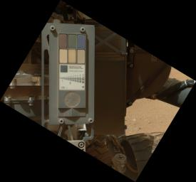 This view of the calibration target for the MAHLI camera aboard NASA's Mars rover Curiosity combines two images taken by that camera during Sept. 9, 2012. Part of Curiosity's left-front and center wheels and a patch of Martian ground are also visible.