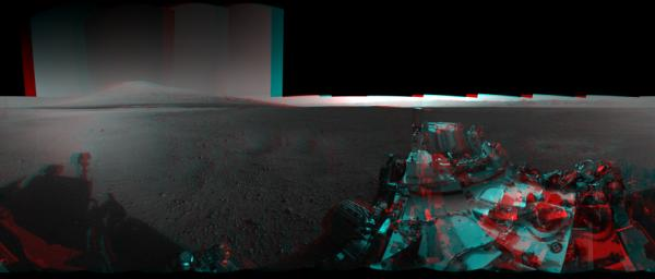 This 3D image from NASA's Curiosity was taken from the rover's Bradbury Landing site inside Gale Crater, Mars. Between the rover on the right, and its shadow on the left, looms the rover's eventual target: Mount Sharp.