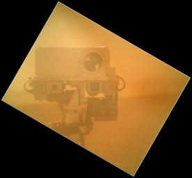 On Sol 32 (Sept. 7, 2012) the Curiosity rover used a camera located on its arm to obtain this self portrait. The MAHLI cover was in the closed position in order to inspect the the dust cover.