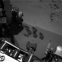 NASA's Mars rover Curiosity used a mechanism on its robotic arm to dig up five scoopfuls of material from a patch of dusty sand called 'Rocknest,' producing the five bite-mark pits visible in this image from the rover's left Navigation Camera (Navcam).