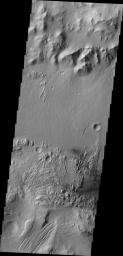 Moving eastward from the previous image, we continue to see the northern floor and rim of Gale Crater and the northern part of Mt. Sharp. This image from NASA's Mars Odyssey spacecraft shows a weathered region of the lower elevations of Mt. Sharp.