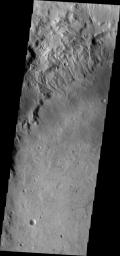 Many small channels dissect the rim of Martz Crater, as shown in this image captured by NASA's 2001 Mars Odyssey spacecraft.