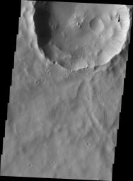 Dark slope streaks mark the rim of this unnamed crater near Schiaparelli Crater as seen by NASA's 2001 Mars Odyssey spacecraft.
