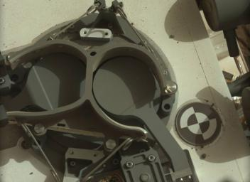 This subframe image from the left Mastcam on NASA's Mars rover Curiosity shows the covers in place over two sample inlet funnels of the rover's Sample Analysis at Mars (SAM) instrument suite.