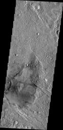This image from NASA's 2001 Mars Odyssey spacecraft shows a young crater. Dark radial spokes are created by the explosive blast of an impact event. With time, only thick ejecta near the rim of the crater will be visible, and dark spokes will disappear.
