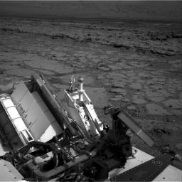 The NASA Mars rover Curiosity used its left Navigation Camera to record this view of the step down into a shallow depression called 'Yellowknife Bay.' The descent into the basin crossed a step about 2 feet high, visible in the upper half of this image.