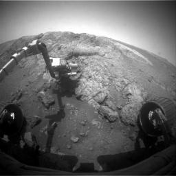 This image from NASA Mars Exploration Rover Opportunity shows the rover's arm extended for examination of a target called 'Onaping' at the base of an outcrop called 'Copper Cliff' in the Matijevic Hill area of the west rim of Endeavour Crater.