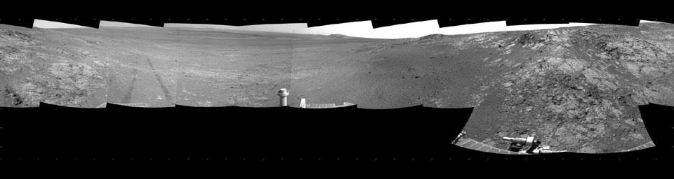 This full-circle, panorama shows the terrain around the NASA Mars Exploration Rover Opportunity on part of a relatively flat, light-toned outcrop called 'Whitewater Lake.' The basin of Endeavour Crater is in the left half of the image.