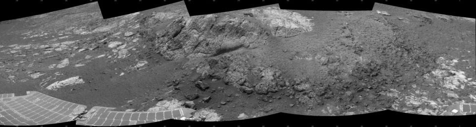 This 180-degree mosaic of images from the navigation camera on the NASA Mars Exploration Rover Opportunity shows the rover close to the outcrop called 'Copper Cliff,' which is in the center of this scene.