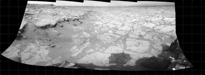 In a shallow depression called 'Yellowknife Bay,' the NASA Mars rover Curiosity drove to an edge of the feature to record this view of the ledge at the margin and a view across the 'bay' during the 130th Martian day, or sol, (Dec. 17, 2012).