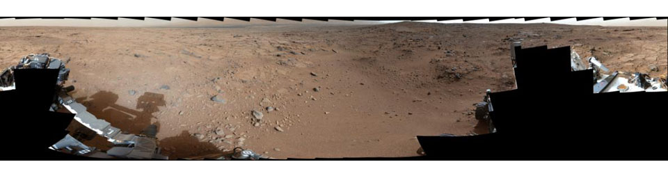 On Nov. 22, 2012, or sol 106, NASA's Mars rover Curiosity was near a location called 'Point Lake' for an overlook of a shallow depression called 'Yellowknife Bay' which is in the left third of this scene, in the middle distance.