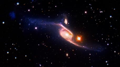 This composite of the giant barred spiral galaxy NGC 6872 is 522,000 light-years across, making it about five times the size of the Milky Way.