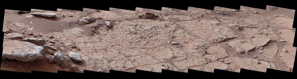 This wide view of the 'John Klein' location selected for the first rock drilling by NASA's Mars rover Curiosity is a mosaic taken by Curiosity's right Mast Camera (Mastcam).