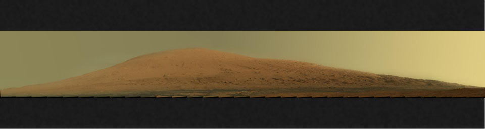 This mosaic of images from the Mastcam onboard NASA's Mars rover Curiosity shows Mount Sharp in raw color. Raw color shows the scene's colors as they would look in a typical smart-phone camera photo, before any adjustment.