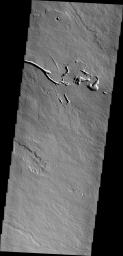 The lava flows and collapse features in this image from NASA's 2001 Mars Odyssey spacecraft are located near Ascraeus Mons.