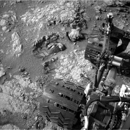 This view of Curiosity's left-front and left-center wheels and of marks made by wheels on the ground in the 'Yellowknife Bay' area comes from one of six cameras used on Mars for the first time more than six months after the rover landed.
