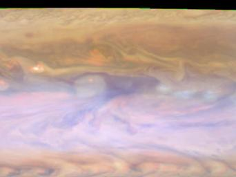 The dark hot spot in this false-color image from NASA's Cassini spacecraft is a window deep into Jupiter's atmosphere. All around it are layers of higher clouds, with colors indicating which layer of the atmosphere the clouds are in.