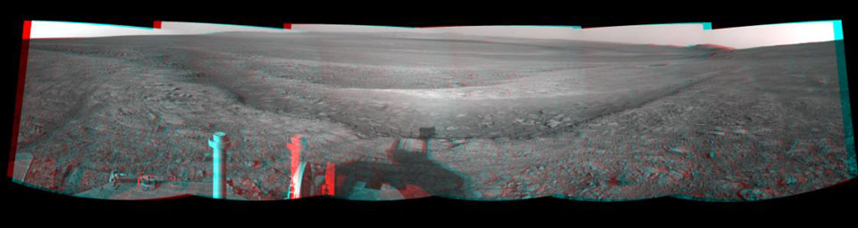 This 3-D view from the navigation camera on NASA's Mars Exploration Rover Opportunity shows a vista across Endeavour Crater, with the rover's own shadow in the foreground.