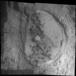 This mosaic shot by the microscopic imager on the robotic arm of NASA's Mars Exploration Rover Opportunity shows a rock target called 'Esperance' after some of the rock's surface had been removed by Opportunity's rock abrasion tool.