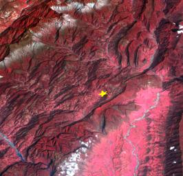 This image from NASA's Terra spacecraft highlights the epicenter of a powerful magnitude 6.6 earthquake which struck Sichuan Province in southwest China on April 20, 2013. Vegetation is displayed in red; clouds and snow are in white.