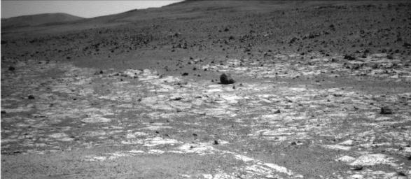 NASA's Opportunity used the navigation camera (Navcam) on its mast to capture this southward facing scene along the eastern flank of 'Solander Point' during the 3,387 Martian day, or sol, of the rover's work on Mars (Aug. 3, 2013).