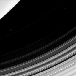 Saturn's D ring is easy to overlook since it's trapped between the brighter C ring and the planet itself. In this view from NASA's Cassini spacecraft, all that can be seen of the D ring is the faint and narrow arc as it stretches from top right of the ima
