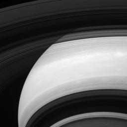 Saturn's rings cast shadows on the planet, except their shadows appear to be inside out in this image captured by NASA's Cassini spacecraft.